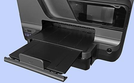 přední zásobník + plocha pro výjezd výtisků či kopií